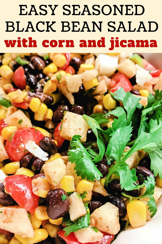 Seasoned Black Bean Salad with jicama, corn, and tomatoes, garnished with cilantro.