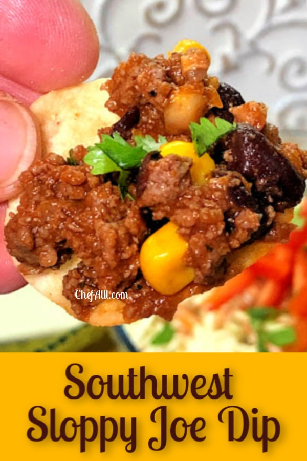A tortilla chip topped with beef sloppy joe mixture.