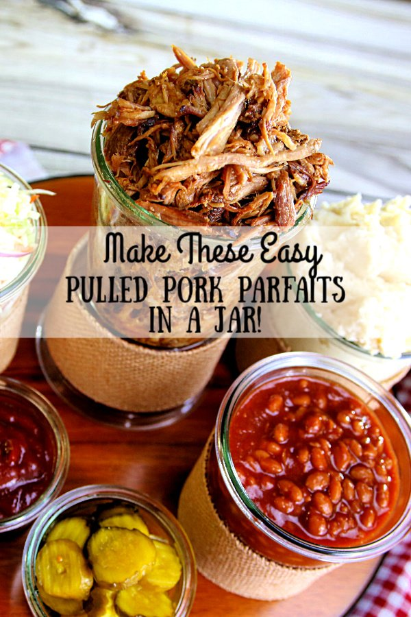 Pulled Pork Parfaits loaded with mashed potatoes, baked beans, pulled pork, and cole slaw with pickles on top.