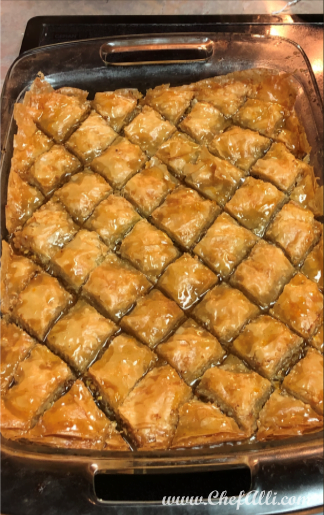 Baklava is basically a little party in your mouth. It's truly delicious and worth every minute it takes to create. Made of layer upon layer of buttered phyllo filled with chopped nuts and dried fruit, baklava is held together with a special syrup that changes the texture of this pastry from flaky and crisp, to tender and soft!