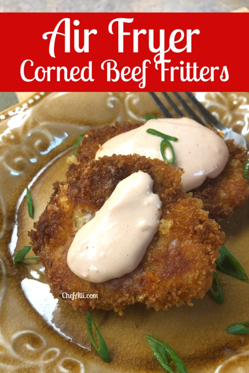Two corned beef fritters with sauce and fork