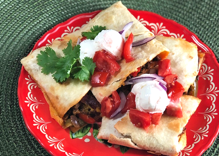 Slabs of Beefy Sheet Pan Quesadillas make a wonderful appetizer or snack.