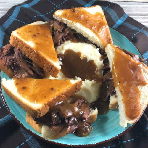 plate of hot beef sandwiches with mashed potatoes and gravy
