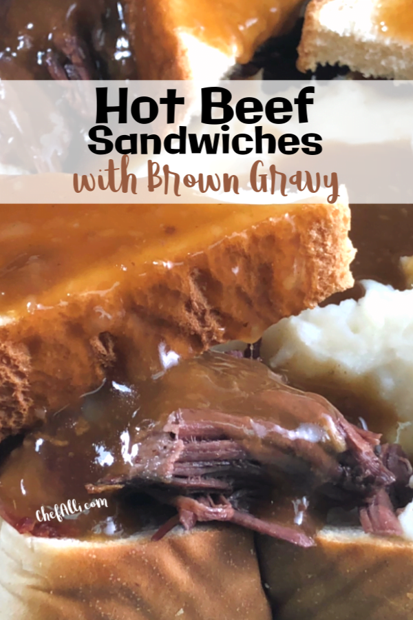 An upclose shot of a shredded roast beef between two slices of white bread, smothered in brown gravy.