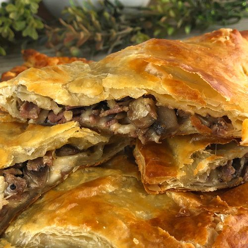 Puff Pastry Roast Beef Packets stacked on a platter.