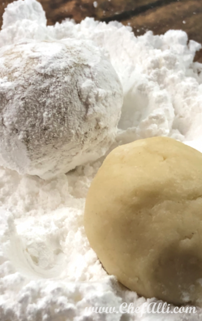 If you're not familiar with Russian Tea Cakes, don't be misled by the title. You will love how these little puffs of sweetness are a delightful little cookie, rolled in powdered sugar and perfect for your Christmas dessert table. They're also so easy to make, that even the smallest helpers can take part!