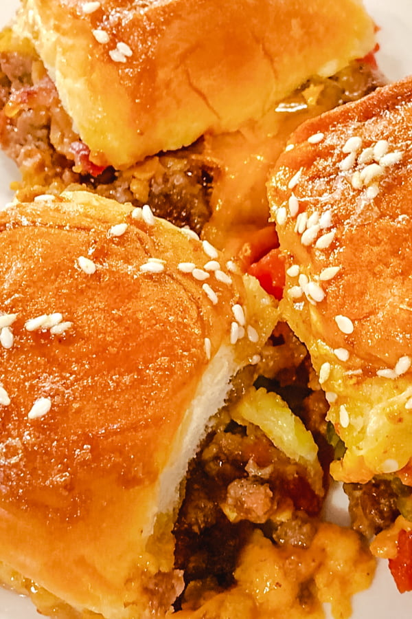 Bacon Cheeseburger Sliders laid out in a casserole dish.
