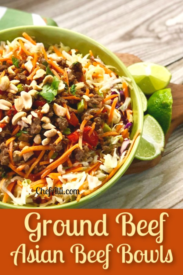 Green bowl of Asian Beef with veggies slaw on top.