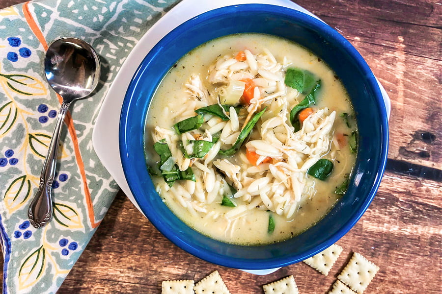 An overhead shot of Instant Pot Chicken Orzo Soup with crackers.