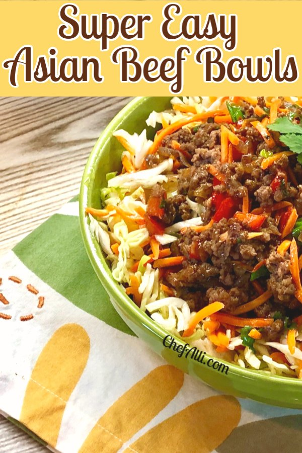 Side view of easy Asian Beef Bowls with veggie slaw on top.