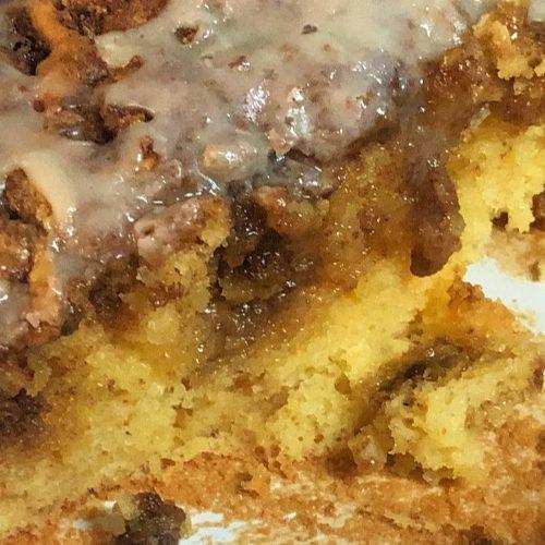 Honey bun cake in a cake pan.