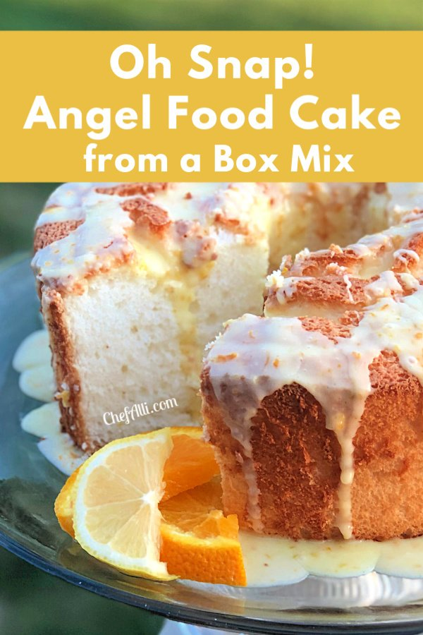 Angel Food Cake Citrus Glaze (made from a box mix) sitting on a cake stand.