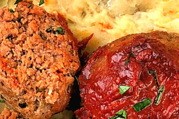 What screams comfort food louder than a good, classic meatloaf? With a tangy glaze, these moist and tender Tomato-Glazed Meatloaf Bundles are sure to become a family favorite! Serve them on a bed of whipped mashed potatoes. #groundbeef #meatloaf #bundles #easy #family
