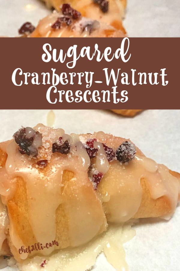 Pop open that tube of crescent roll dough you've got tucked away in fridge! You are just moments away from golden brown pillows of flaky rolls, filled with sugared cranberries and toasted walnuts, then drizzled with a warm powdered sugar glaze. These Glazed Crescents with Cranberries and Walnuts are tender, buttery, and so easy a 5-year old can whip them. #CrescentRolls #cranberries #walnuts #easy #breakfast #brunch #tender #flaky