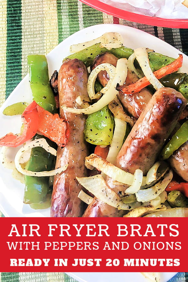 A white plate loaded with cooked brats and vegetables.