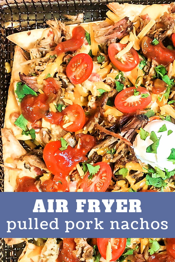 A big batch of Pulled Pork Nachos with Mexican-inspired toppings.