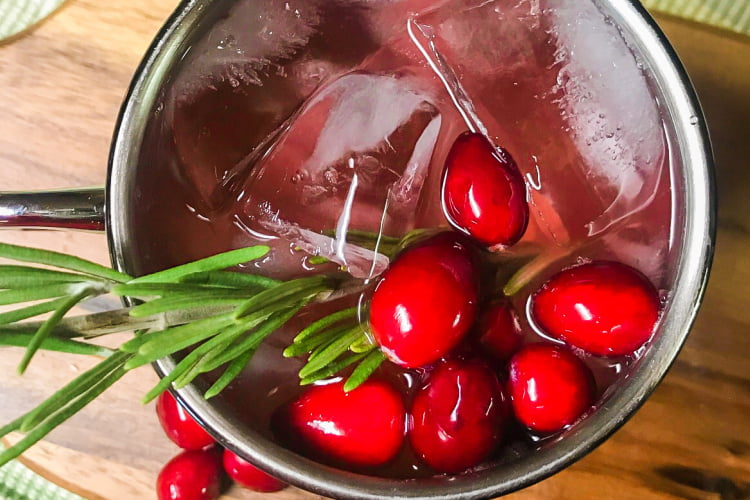 Overhead shot of a beautiful Cranberry Moscow Mule cocktail.