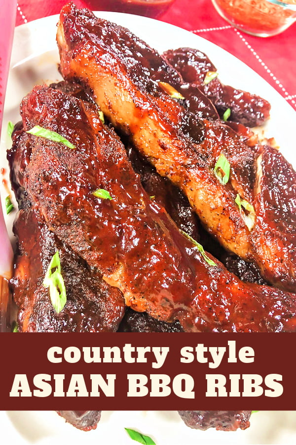 Slather bbq ribs piled high on a platter.