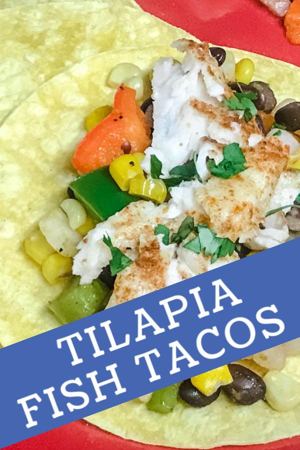 Crumbled tilapia on top of a sweet potato hash and a corn tortilla.