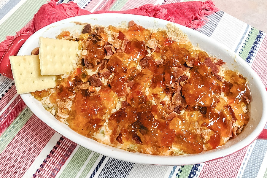 A casserole dish loaded with air fryer pepper jelly cheese dip.