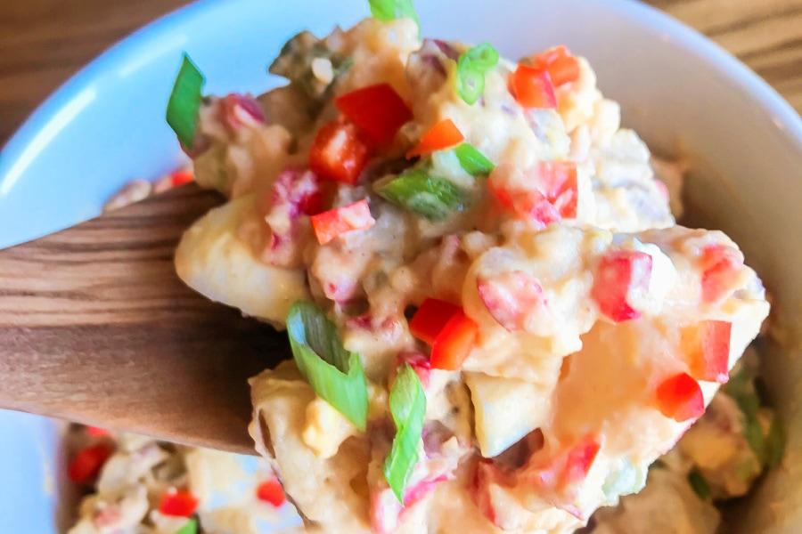 A big serving spoonful of creamy potato salad.