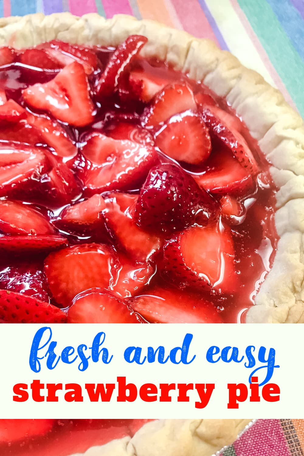 A whole freshly made chilled strawberry pie.